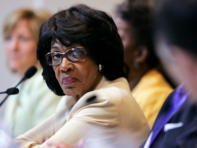 Maxine Waters glares at someone