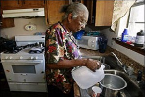 poor old woman in kitchen