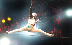 circus performer balancing on highwire