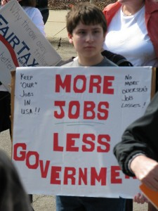 "kid with sign - ""More Jobs, Less Government"""
