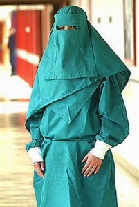 woman in full burqa - green
