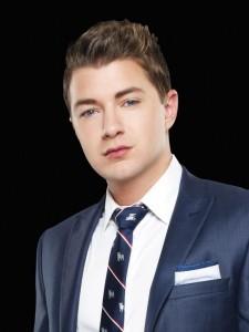 Taylor Garrett in blue suit