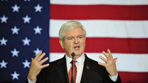 Gingrich speaking in front of American flag