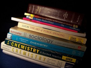 stack of textbooks and a Bible
