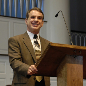 William Lane Craig smiling at podium