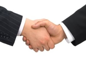 two hands grasping in business handshake