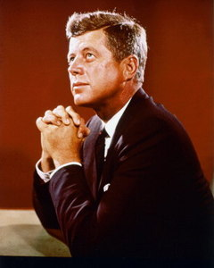 President Kennedy kneeling in prayer
