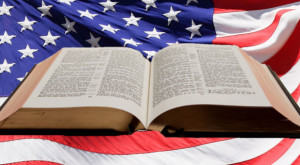 Bible laid open across American flag