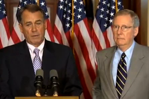 Boehner and McConnell at podium - flags behind