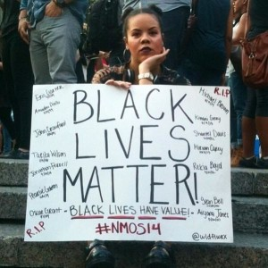Woman with Black Lives Matter placard