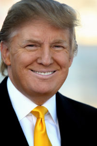 smiling-trump-black-jacket-gold-tie